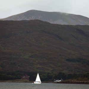 The peaks of Rum tower over the anchorage of Loch Scresort.