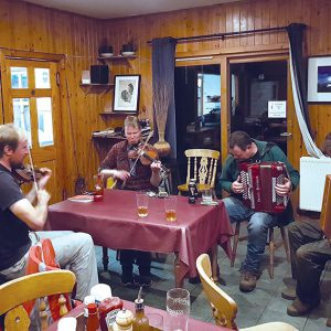 Ronan (left) leading the ceilidh players in Eigg's pub.