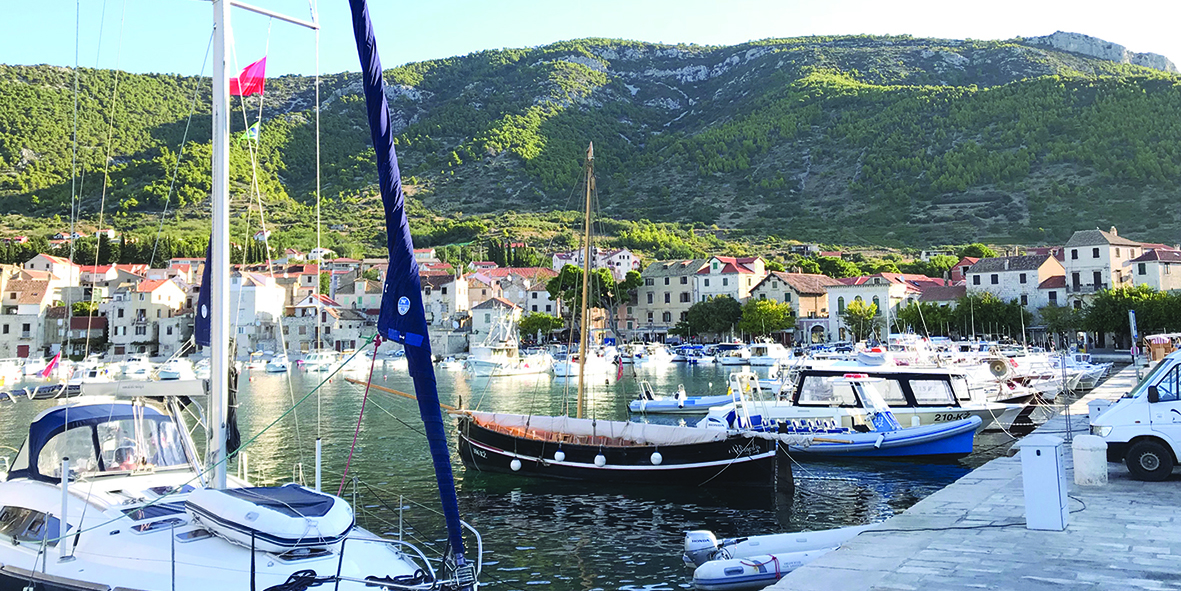 Komiza on the island of Vis is nestled snugly into the base of the mountains