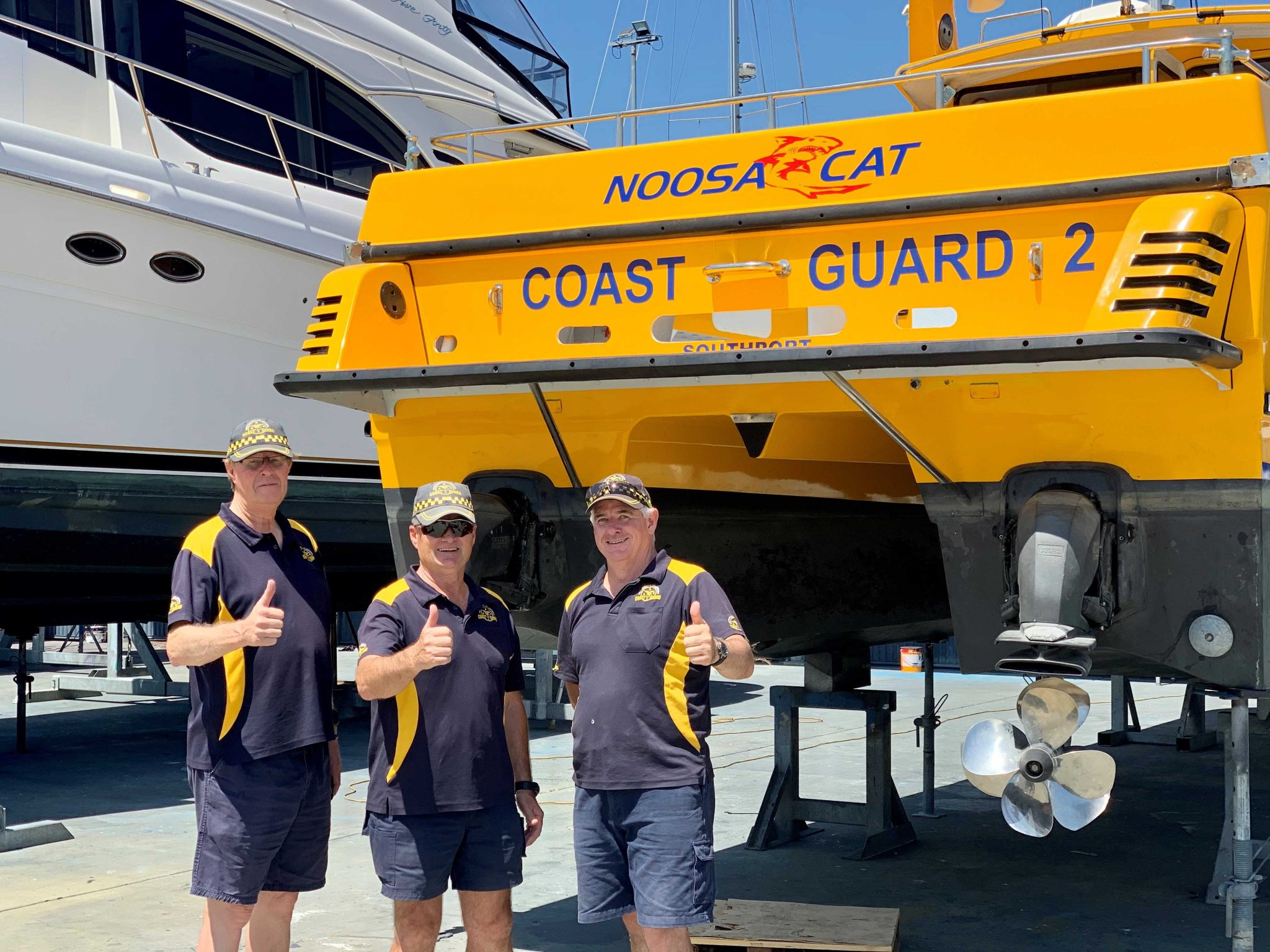 Craig Mills, Commander Mike Hoffman, Danny Nugent GC Coast Guard Southport November 2019 The Boat Works