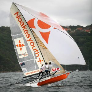Jacqui Bonnitcha drives her Noakes Youth skiff hard at the 2007 JJ Giltinan Championship on Sydney Harbour