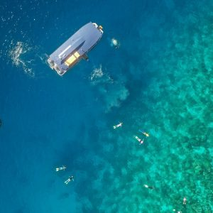 Coral Expeditions aerial over the Reef while guests snorkel