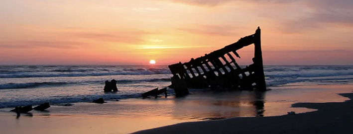 The wreck of the Peter Iredale in the Fort Stevens State Park, Oregon, USA, at sunset ROBERT BRADSHAW, WIKIMEDIA COMMONS