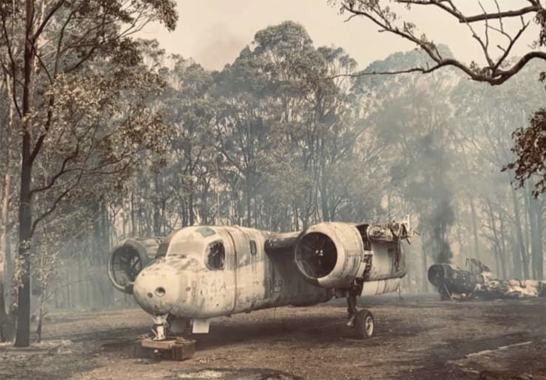 Meteorologist Malcolm Riley attends a Naval Meteorological Service reunion in Nowra NSW - Two Tracker aircraft near Nowra during 2019 bushfires