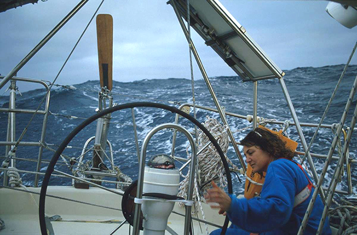 Kay Cottee adjusting the vane steering equipment in the Indian Ocean