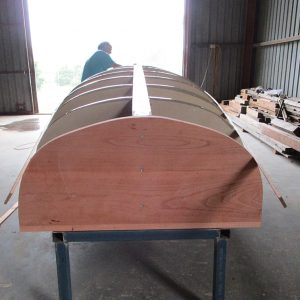 Scarborough Engineering River Launch - Main backbone components are fastened together, and the transom knee and stem are fitted.
