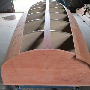 Scarborough Engineering River Launch - The Red Cedar planking is fitted around the station moulds and screwed in place to form the shape of the hull, the planks are then edge glued.