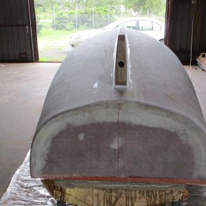 Scarborough Engineering River Launch - The hull core is sanded and faired and then epoxy sheathed using West Systems Resin, the hardwood keel is then shaped and fitted to the hull. The keel is then bored to take the shaft tube assembly.