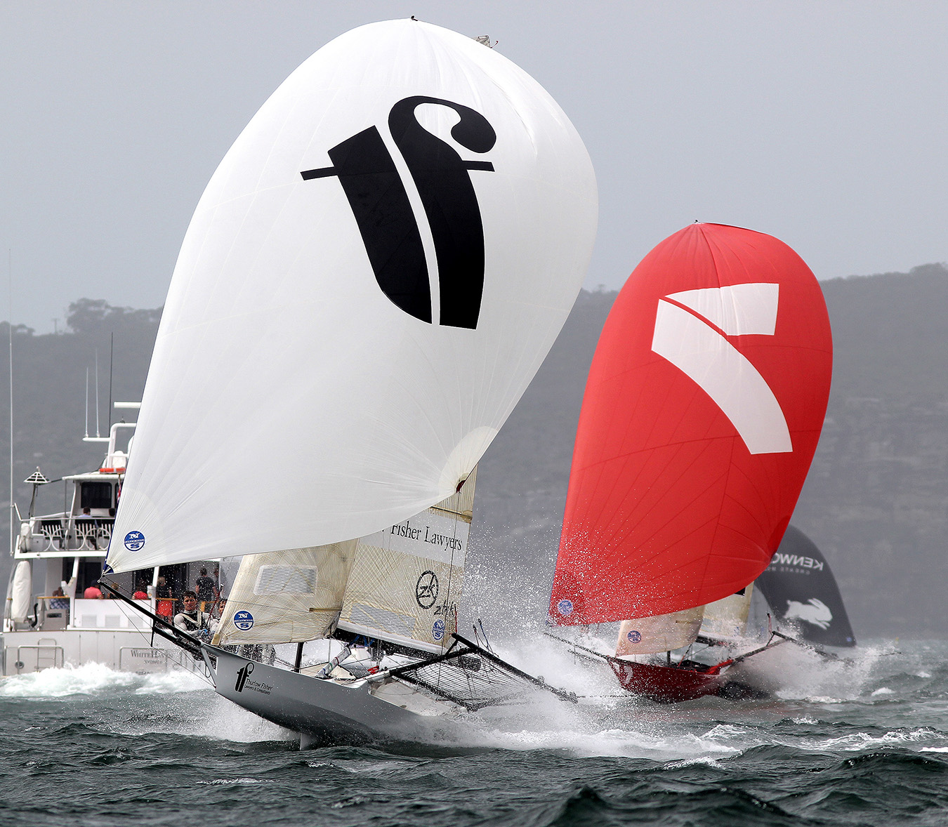 Thurlow Fisher Lawyers leads Gotta Love It 7 down the spinnaker run from the Beashel buoy