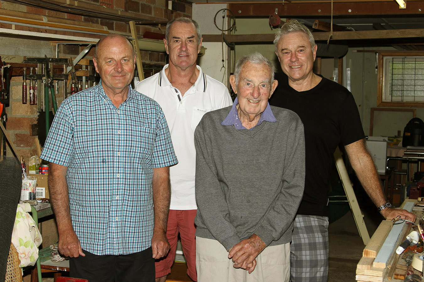 18ft Skiffs The Kulmar Family - From left, Paul Ziems, Paul Kulmar, the late Les Kulmar, Stephen Kulmar in the garage under the Kulmar family home (2014)