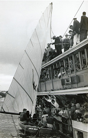 Jantzen Girl III accepts the winner's ribbon for 1958 Giltinan World Championship victory