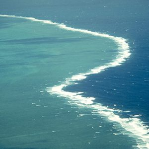 Waves break on the outer edge of Hook Reef. Copyright Commonwealth of Australia (GBRMPA) Photo R. Walls