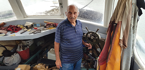 Frank Illacqua on his decommissioned fishing boat, one of only two left in Iron Cove
