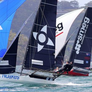 Yvette Heritage drives her Noakes Blue skiff hard in a high speed spinnaker run with Smeg