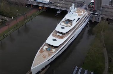 Superyacht towed through narrow canal in Netherlands