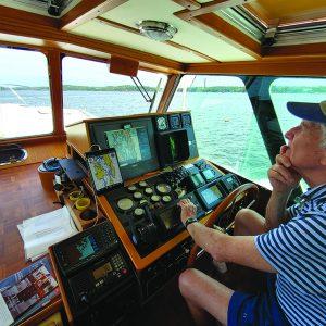 Captain Steve Kaufman navigates through a sea of lobster pots