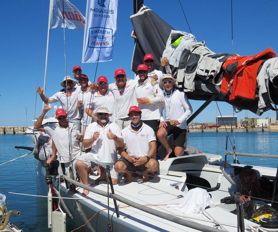 A delighted crew celebrates their line honour victory after tidying the boat up. - photo credit Mark Loader.